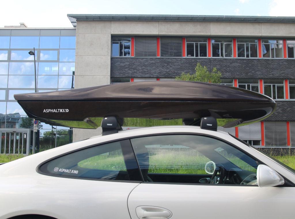 Cropfiber Asphaltkind Dachbox auf Porsche 911